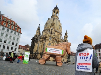 Members of the federation for environment and conservation (BUND) protest in front of the Frauenkirche with a Trojan Horse against the Transatlantic Trade and Investment Partnership (TTIP) between the EU and the US in Dresden, Germany, 06 November 2014. With the call 'EU-US trade agreement stops the Trojan Horse' the demonstrants want to call attention to the non-transparency of the agreement and the possible consequences for EU citizens. Photo by: Matthias Hiekel/picture-alliance/dpa/AP Images